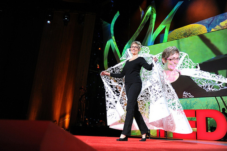 """Beatrice wearing her """"magic cape"""" during her TED Talk """"Stories Cut From Paper."""" Photographed by James Duncan Davidson."""