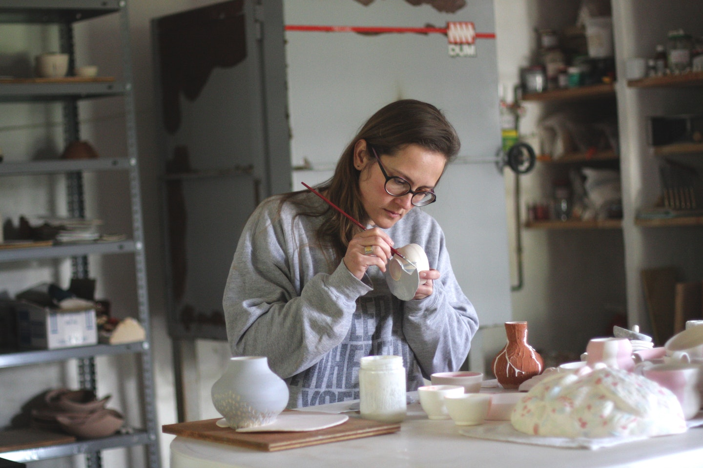 Anastasia, a VAWAA artist, teaches guests how to make different types of ceramic-ware in Spain.