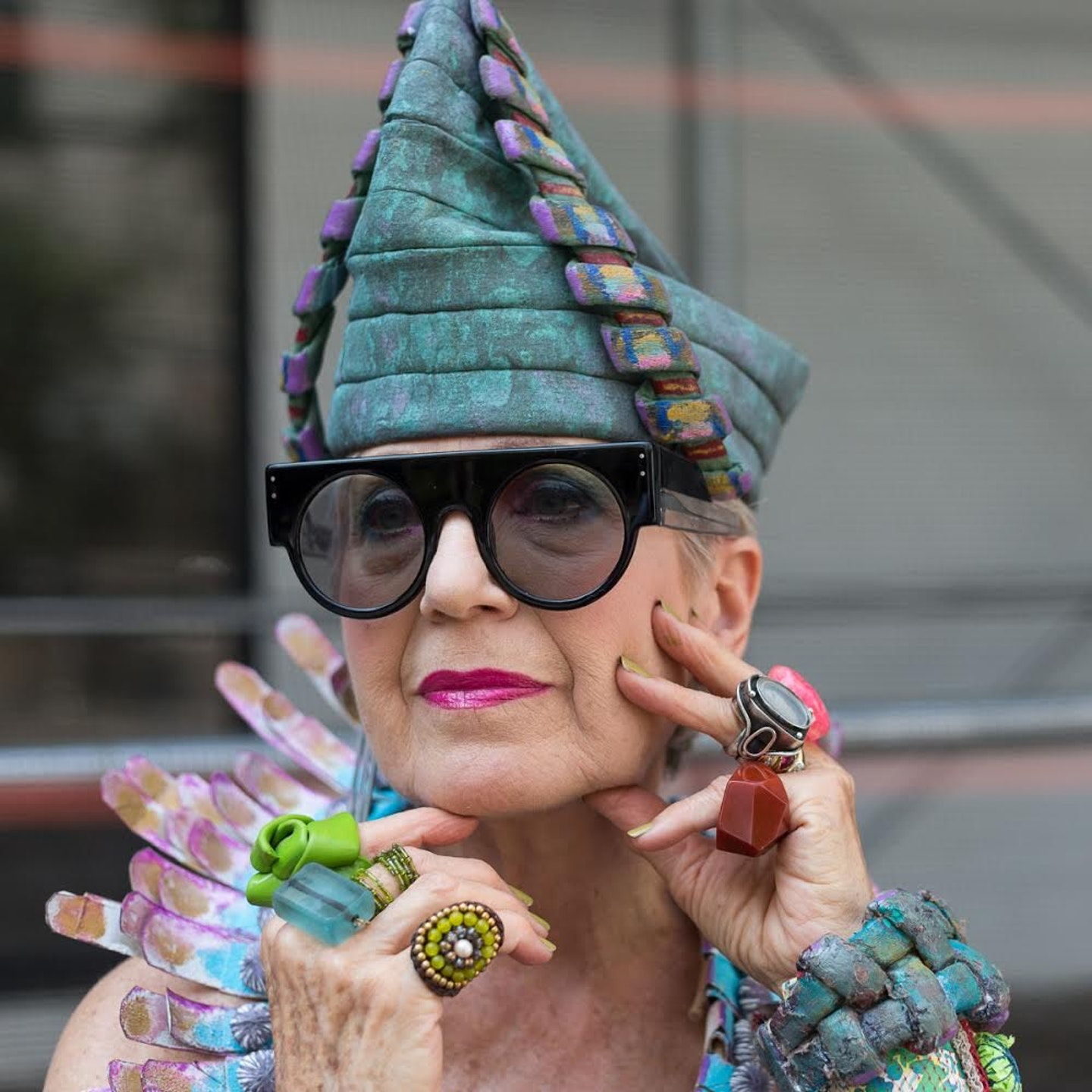 Artist Debra Rapoport wearing a hat she made from paper towels. Photographed by Denton Taylor.