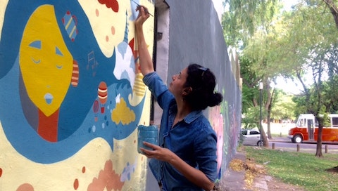 Sarika learning to paint a mural during her VAWAA with master street artist Pum Pum in Buenos Aires, Argentina. Courtesy of Sarika Pandit.