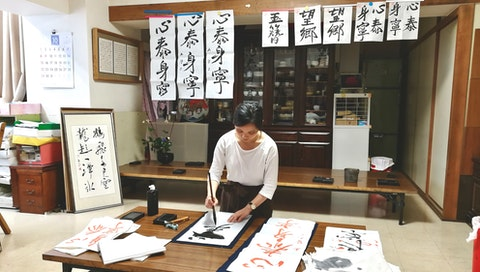 You can seek out creativity in a calligraphy studio in Japan or your own backyard. Courtesy of Kate Tram Nguyen.
