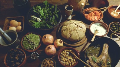 Bake ancient Roman bread for a Middle Ages meal.