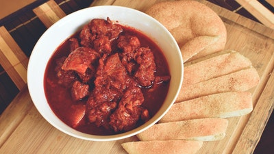 Preparing Portuguese-style dishes like East Indian vindaloo