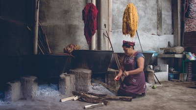Woman in Oaxaca, Mexico, preparing natural dyes from cochineal, indigo, mosses and barks in her traditional Zapotec studio. Join her for a private workshop to learn natural dyeing fabric techniques #creativevacation #vawaa  #travelmexico #oaxaca #creativity #naturalfabricdyeing #naturaldyes #slowtravel #cochineal #crafts #howtomake