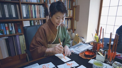 Impeccable body posture is integral in the practice of calligraphy.