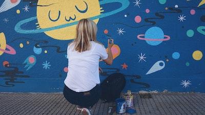 Street artist at work: Pum Pum working on a space themed wall mural in Buenos Aires via Vacation with an Artist  #creativevacations #vawaa #streetart #urbanart #buenosaires #slowtravel #wallmurals #creativity #argentina