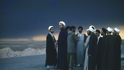 """Mullahs at the Front of the Iran-Iraq War (1980-1988), watching burning Iraqi oil wells hit by the Iranian armed forces (1983)."""